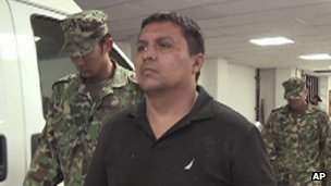 "Former leader of drugs Mexican cartel ""Los Zetas"", Miguel Angel Trevino Morales, aka ""El Z-40"" escorted by marines after his arrest"