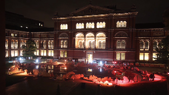 The V&A at night, with Travelling to the Wonderland installation in progress