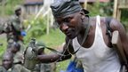 A Congolese soldier pouring water on his face - Jomba, DR Congo - Wednesday 30 October 2013