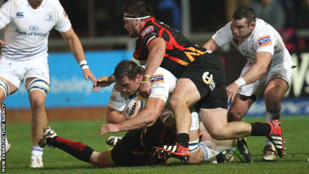 Leinster back-row Rhys Ruddock takes on the Dragons defence