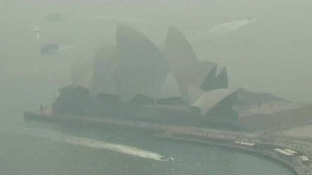 Sydney Opera House shrouded by smoke