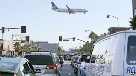 Cars are backed up over a mile as air traffic begins after a shooting at Terminal 3 caused a shutdown at Los Angeles International Airport, on 1 November 2013, in Los Angeles