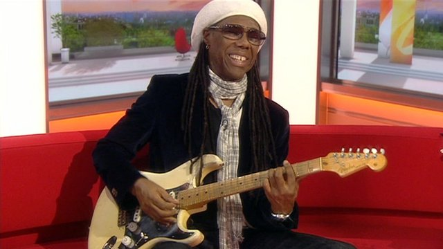Musician Nile Rodgers performs on the BBC Breakfast sofa