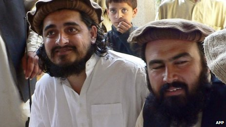 The then new Pakistani Taliban chief Hakimullah Mehsud (L) sitting with his commander Wali-ur Rehman (R) during a meeting with local media representatives in South Waziristan on 4 October 2009
