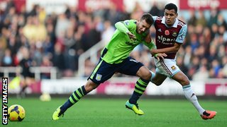 Andreas Weimann of Aston Villa challenges for the ball with Ravel Morrison