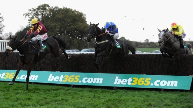 Harry Topper leads the Charlie Hall Chase field at Wetherby