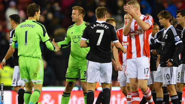 Asmir Begovic shakes hands with Artur Boruc at the end of Stoke's draw with Southampton