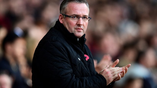 Paul Lambert keeps warm on the touchline during Aston Villa's 0-0 draw at West Ham