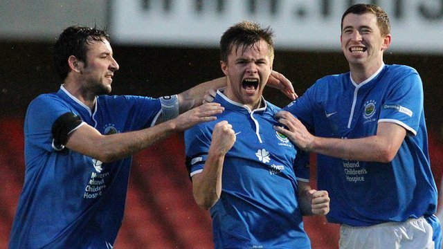 Linfield's Michael Gault, Niall Quinn and Billy Joe Burns celebrate victory over Ards at Windsor Park