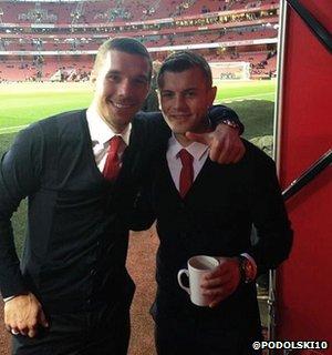 Arsenal players Lukas Podolski and Jack Wilshere