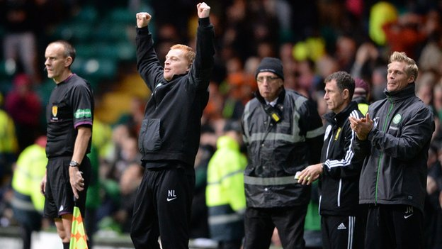 Celtic manager Neil Lennon salutes Charlie Mulgrew's equaliser against Dundee United