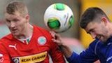 Cliftonville's Martin Murray closes in as Glenavon opponent Cameron Grieve heads clear