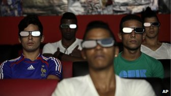 People watch a 3D movie at a private movie theater in Havana, Cuba, October 28, 2013