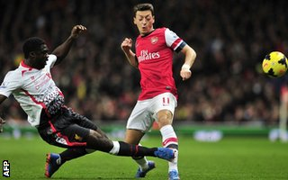 Kolo Toure tackles Mesut Ozil