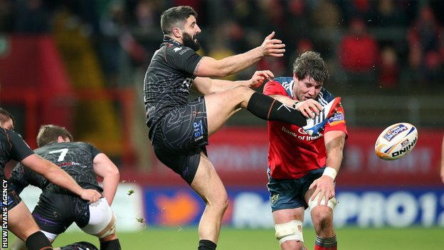 Munster's Dave O'Callaghan blocks a kick from Tito Tibaldi of Ospreys