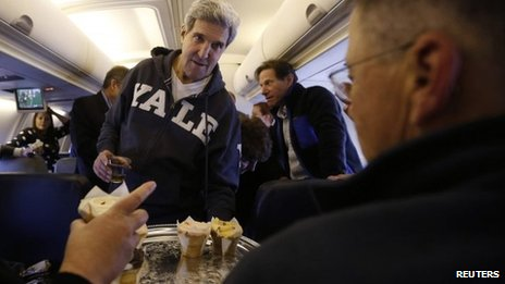 Secretary Kerry handing out cupcakes to the press corps accompanying him, November 2nd