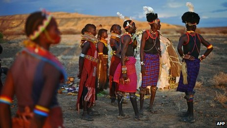 Men and women from the Turkana tribe take part in a ceremeony in the Sibiloi national Park in the Turkana region