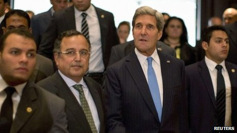 US Secretary of State John Kerry walks with Egypt's Foreign Minister Nabil Fahmy (front 2nd L) to their joint news conference in Cairo, 3 November 2013