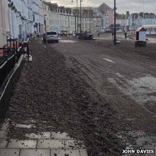 This shows shingle left on Aberystwyth seafront after the waves had crashed over it