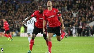 Steven Caulker celebrates his goal for Cardiff
