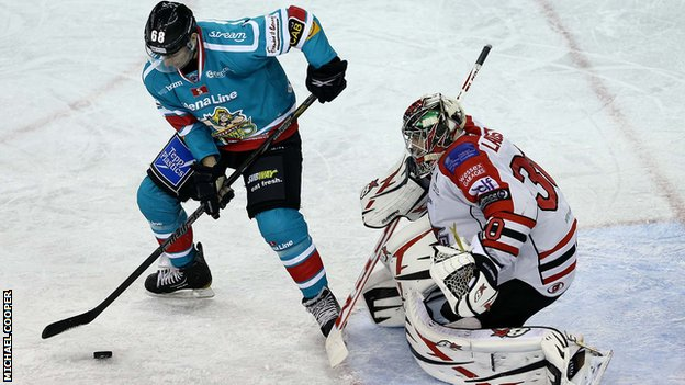 Belfast's Chris Higgins attempts to beat Devils netminder Daniel LaCosta