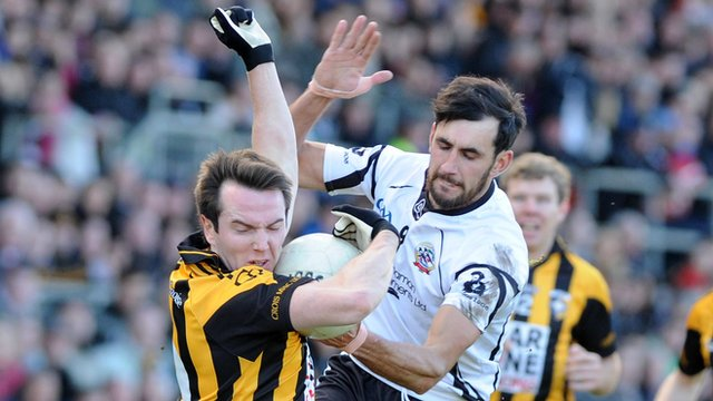 Crossmaglen's Tony Kernan is challenged by Aidan Brannigan of Kilcoo