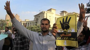 Pro-Morsi supporter gesturing with four-finger salute (04/11/13)