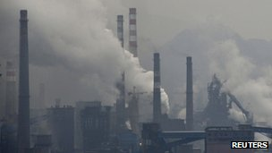 Smoke rises from chimneys and facilities of steel plants on a hazy day in Benxi, Liaoning province, 3 November 2013