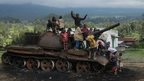 In Kibumba, children play on a former M23 tank. The rebels burned it before retreating.