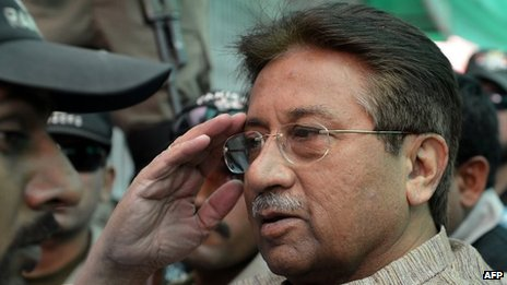 In this photograph taken on April 20, 2013, Former Pakistani president Pervez Musharraf (C) is escorted by soldiers as he salutes on his arrival at an anti-terrorism court in Islamabad.