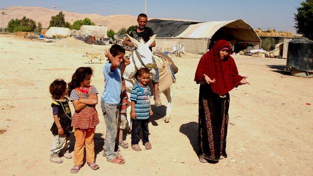 Jamilla Adeis (right) with family in village of Abu al-Ajaj