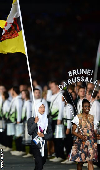 Maziah Mahusin carries the Brunei flag at the opening ceremony of the London Olympics