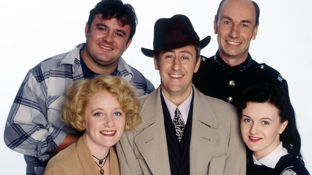 (clockwise from centre) Nicholas Lyndhurst as Gary Sparrow, Michelle Holmes as Yvonne Sparrow, Victor McGuire as Ron Wheatcroft, Christopher Ettridge as PC Reg Deadman and Dervla Kirwan as Phoebe Bamford