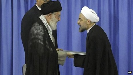 Ayatollah Khamenei (left) and Hassan Rouhani (file photo)