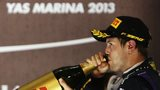 Sebastian Vettel drinks champagne at Yas Marina