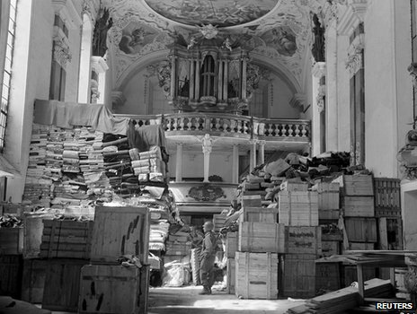 Nazi-looted art guarded by US soldier in church in occupied Germany, 1945