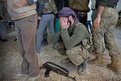 Free Syrian Army fighter grieves for a fallen comrade