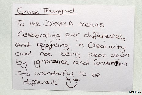 "postcard reads, ""to me, dyspla means celebrating our differences..."""