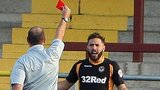Newport's Robbie Willmott receives a red card from referee Andy Haines