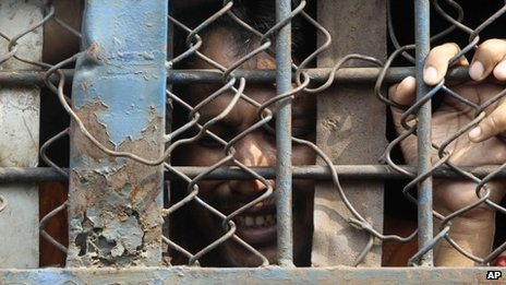 A convicted border guard cries inside a prison van as he leaves the special court on Tuesday (5 November)