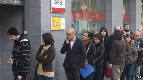 People queue outside a government unemployment office in Madrid, Spain, on 5 October 2013