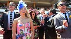 Racegoers celebrate at Melbourne Cup