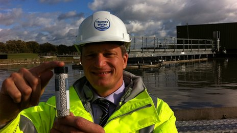 Piers Clark, commercial director at Thames Water at Slough sewage works holding a sample of the phosphate pellets