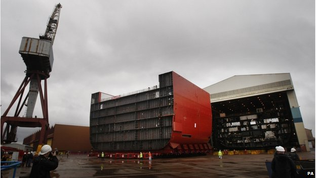 "File photo dated 09/04/12 of a section of the hull of HMS Queen Elizabeth (left) being moved at BAE Systems"" Govan Shipyard in Glasgow"
