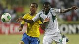 Nigeria's Awoniyi (right) fights for the ball against Sweden's Sonko