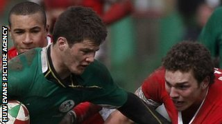 Ireland's Sam Coghlan-Murray tries to fend off Wales' George North as Eli Walker moves in during the 2010 Five Nations Under-18 festival