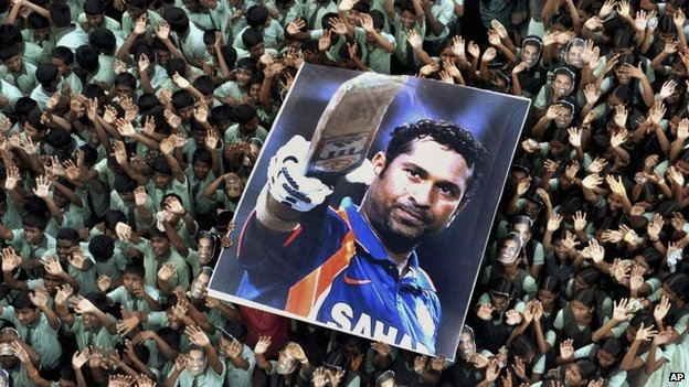 File picture of Indian students holding a large poster of Indian cricketer Sachin Tendulkar