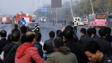 Residents gather near the site of multiple explosions outside the provincial headquarters of China's ruling Communist Party in Taiyuan in north China's Shanxi province 6 November 2013