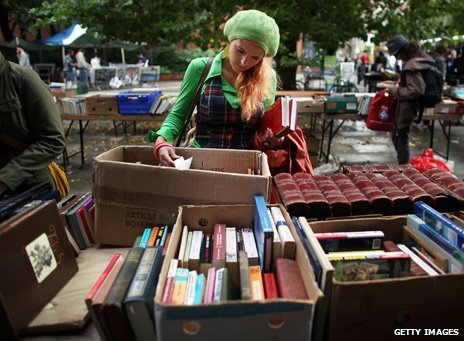 Young woman browsing second-hand books