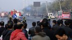 Residents gather near a provincial headquarters of China's ruling Communist Party in Taiyuan, Shanxi province, after a series of bomb blasts, 6 November 2013